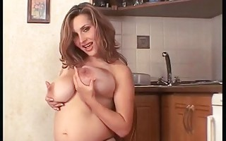 Big breasted pregnant woman masturbating
