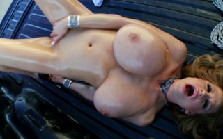 Kelly goes outside and plays with her tits drenched in oil and rubs it into her cunt until she cums