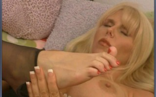 Blue eyed blonde with big titties rips panty hose and shoves glass toy deep in horny pussy.