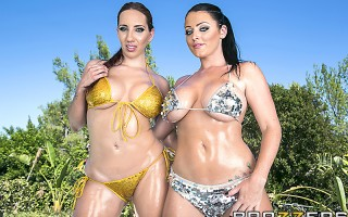 Kelly Divine and Sophie Dee are dancing by the pool. Keiran is laid back watching them, when they take their dance over to his outdoor bed. The girls get him all wet as they squirt all over each other.
