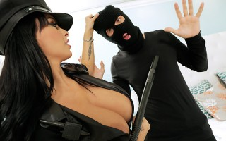 Holly Halston was dressed up as a sexy cop, ready for a little roleplay with her husband, who was supposed to be waiting for her at home. So imagine her surprise when the burglar she confronts in her bedroom isn't her husband at all! Holly quickly takes c