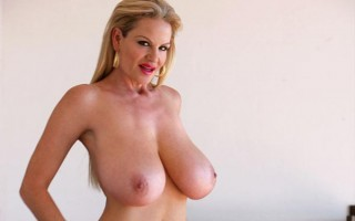 Busty milf Kelly Madison in a red dress in Cabo