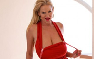 Kelly strips out of her hot red dress to fuck.
