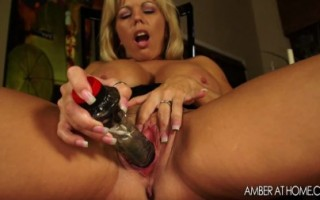 Sexy MILF Amber Lynn Bach takes care of her sexual needs before her friends arrive at her hous.