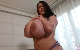 Leanne Crow pulls her enormous breasts from her blue bra