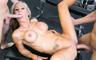 Gym owner Zoey Portland gets a hard workout from two studs.
