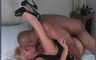 Big tittied blonde MILF in black stockings gets fucked by black dude.