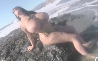 Hey guys! I have my second HD video at the beach and I must say that this is the kind of thing I need to do more often. It is a lot of fun to roll around in the warm sun on the wet sand and let loose with my massive breasts. Hope you like it! :-)