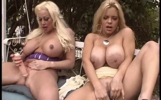 Two mature sluts with huge tits finger their wet pussies