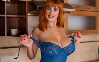 Valory Irene in the kitchen in blue lingerie