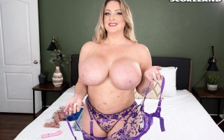 Cheeky blonde sex-bomb Holly Wood in purple lingerie