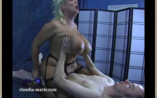 Claudia-Marie rides cowgirl style on a member of her site\'s hard cock