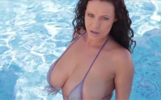 Elle Faye has her big natural titties expose while in the pool