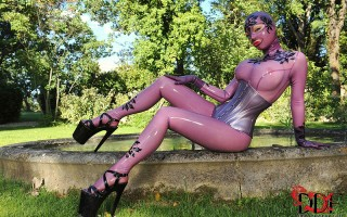 Kinky Latex Lucy In Purple Body Suit Gets Her Pussy Plugged