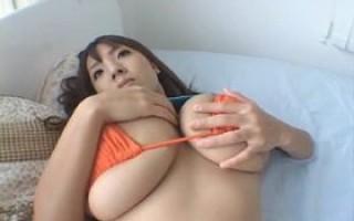 Hitomi Tanaka giant big tits in orange bikini