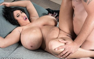 Lucky guy smothered by Roxi Red's giant tits